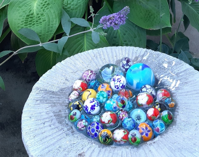 diy bee bath with colorful marbles